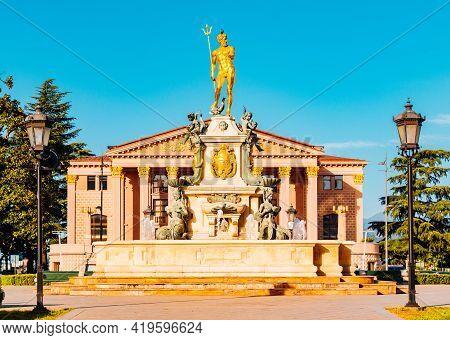 Batumi, Georgy - May 03, 2021: Gilded Statue Of Poseidon Near The Drama Theater.