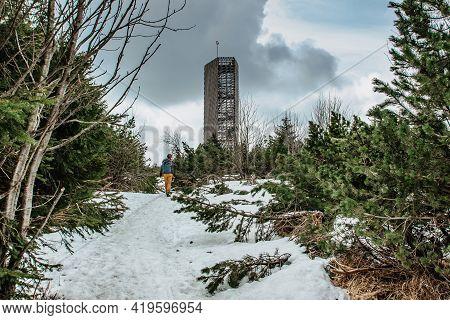 Backpacker Walking To Velka Destna Lookout Tower,orlicke,eagle, Mountains,czech Republic.enjoy Freed