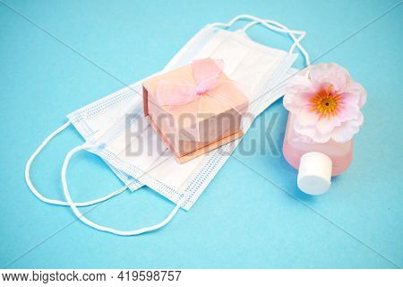 Wedding Ring In A Gift Box And Tree Blossom Flowers And Medical Masks, Wedding In Spring Time Concep