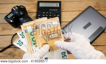 Laptop, Calculator, Digital Camera And Money, Store Selling Photographic Equipment, Pawnshop Concept