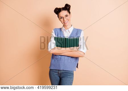 Photo Of Cute Pretty Young Lady Wear Blue Vest Spectacles Embracing Open Book Isolated Beige Color B