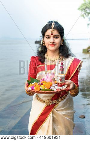 Portrait Of Beautiful Indian Girl In Front Of Ganga River Wearing Traditional Indian Saree, Gold Jew