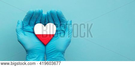 Doctors Hands Wearing Surgical Gloves Holding Poland Flag Heart