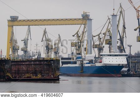 Shipyard - Ship On The Background Of Industrial Infrastructure