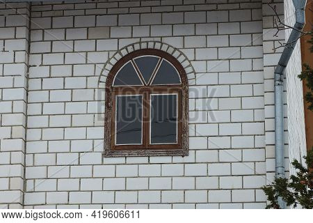 One Small Brown Window On The White Bricks Wall Of The House