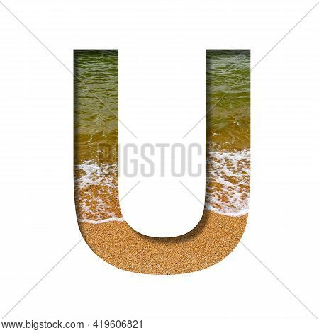 Sea Shore Font. The Letter U Cut Out Of Paper On A Background Of The Beach Of Seashore With Coarse S