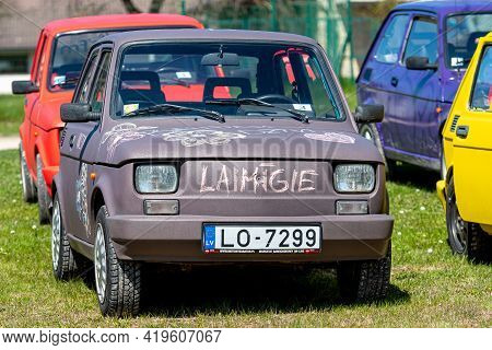 Daugmale, Latvia - May 01, 2021: Several Colorful Oldtimer Rental Cars Fiat 126 On The Lawn Of The P