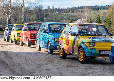 Madona, Latvia - May 01, 2021:  Row Of Colorful Stylish Vintage Fiat 126 Pancars Rental Cars, Pancar