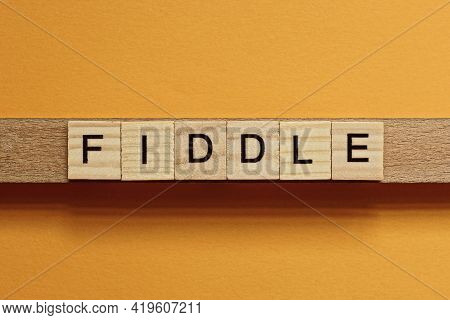 Gray Word Fiddle Made Of Wooden Square Letters On Brown Background