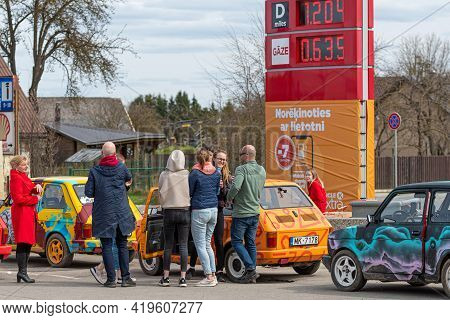 Gulbene, Latvia - May 02, 2021: More Colorful Vintage Cars Fiat 126 Gathered At The Gas Station, A F