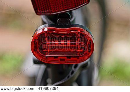 One Red Plastic Warning Light On A Black Sports Bike