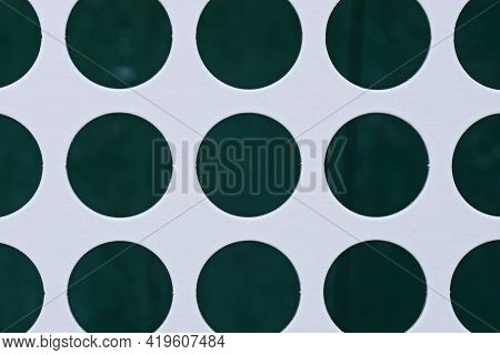 White Sheet Paper Texture With Rows Of Green Circular Holes