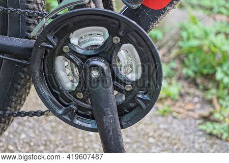 Black Bicycle Pedal On A Metal Sprocket With A Chain On A Sports Bike On The Street