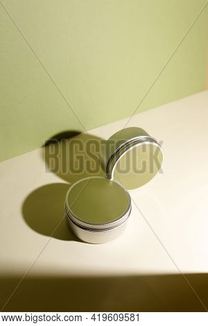 White Cream In Round Aluminum Metal Tin On Neutral Background. Natural Cosmetic Product. Face And Bo
