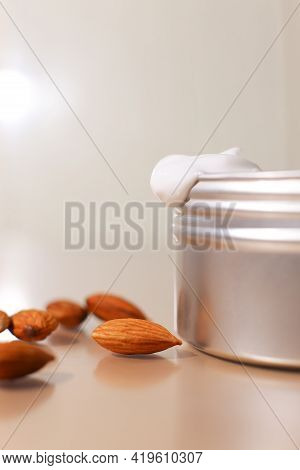 Aluminum Round Jar For Cosmetics With Almonds. Metalic Cosmetic Bottles. Blank Mock Up Advertising C