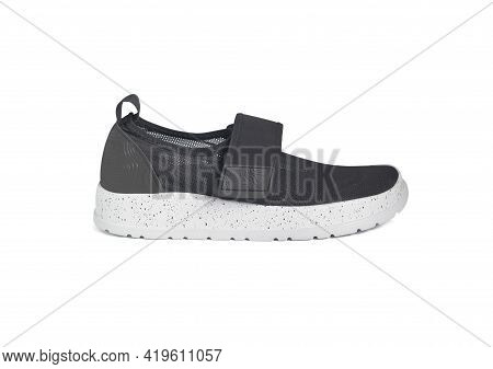 Side View Of Black Slip-on Sneakers. Mesh Breathable Shoe Isolated On White