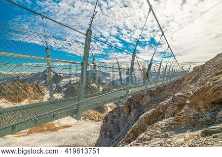 Titlis Cliff Walk Suspension Bridge On Top Of Titlis Mountain With Glacier In The Uri Alps. Viewpoin