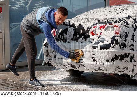 The man washing his car on self-service car wash. Express Car Wash