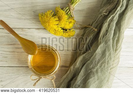 Homemade Delicious Dandelion Jam On A Light Wooden Table With Yellow Dandelions. Dandelion Flower Sy