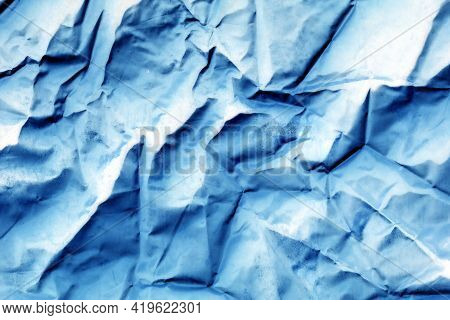 Abstract Background With Blue And White Crumpled Paper. Blue Crumpled Background.