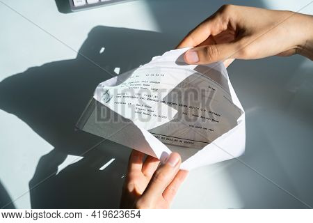 Payroll Cheque In Envelope. Woman Hand Holding Paycheck