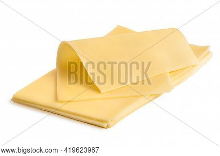 Folded Thin Slice Of Yellow Cheese On Top Of A Stack Of Yellow Cheese Slices.