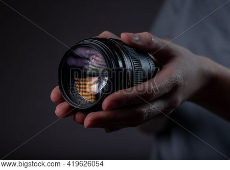 Modern Digital Camera Lens 85 Mm In Hand Over Dark Black Gray Background