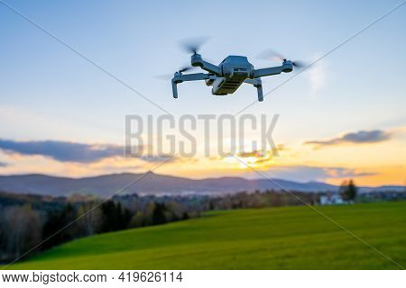 Drone Silhouette At Sunset Time. Unmanned Aerial Vehicle, Uav, Or Uncrewed Aerial Vehicle.