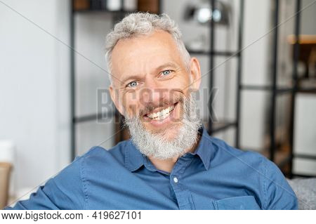 Headshot Of Handsome Charismatic Mature Man In Casual Shirt. Close Up Portrait Of Bearded Grey-haire