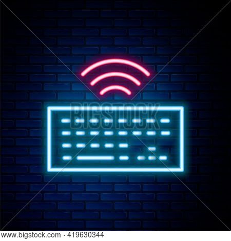 Glowing Neon Line Wireless Computer Keyboard Icon Isolated On Brick Wall Background. Pc Component Si