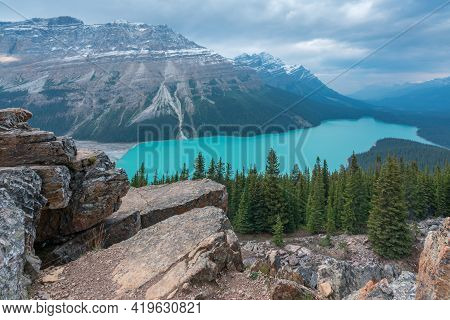 Peyto Lake In Banff National Park On A Very Cloudy And Cold September Day. Glacial Lake In Canadian