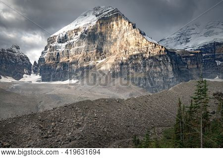 Lefroy Peak In Canadian Rockies Lit By A Sunlight On Otherwise Cloudy Day. Mt.lefroy Viewed From The