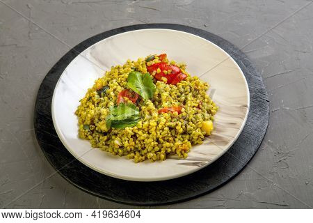 Food For Suhoor In Ramadan Bulgur Post With Vegetables In A Plate On A Gray Background.