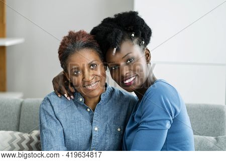 African Teen Support For Elderly Mature Mother