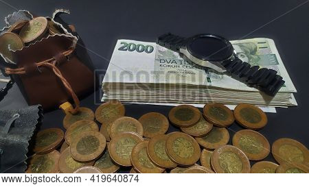 Detail Of Czech 2000 Banknotes Stacked On A Pile On Which A Watch Is Placed, Czech Coins Stacked In
