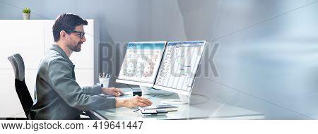 Businessman Checking Calendar Agenda On Computer Screen