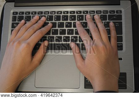 Top View Of Woman Hands View While Using Laptop For Smart Working, Covid-19 Pandemic