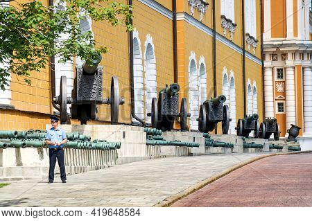 Moscow, Russia - 06 14 2016: A Policeman In Front Of The Old Artillery Exposition In Moscow Kremlin.