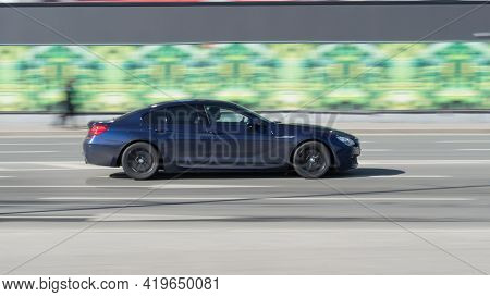 Blue Bmw 6 Series F06 On The City Road. Fast Moving Car On The Street. Vehicle Driving Along The Str