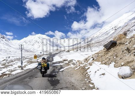 Indian Biker Riding A Bike Through The World Highest Motorable Road Khardungla Pass In Ladakh.