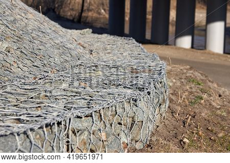 Gabion, A Metal Mesh Filled With Thick Stones. Gambion Wall For Erosion Control