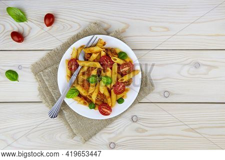 Classic Italian Bolognese Pasta Penne With Tomatoes, Basil On White Wooden Background. Top View, Cop