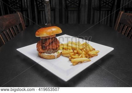 Delicious Buffalo Hot Wing Cheeseburger With All The Fixings On A Bun