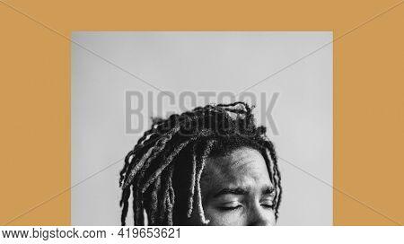 Black man with his eyes shut