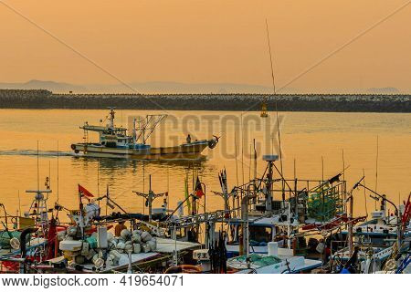 Daecheon, South Korea; April 25, 2021: Small Fishing Boat Coming Into Port At Sunset.