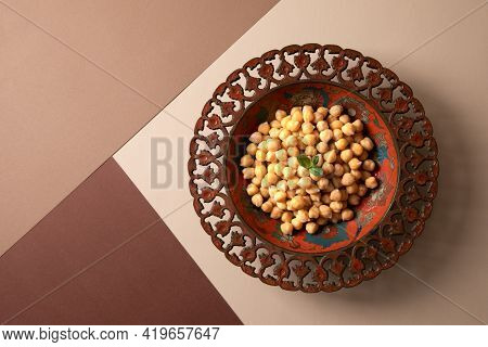 Cooked Chick Peas In A Beautiful Authentic Plate. Spilled Chick Peas. Top View.