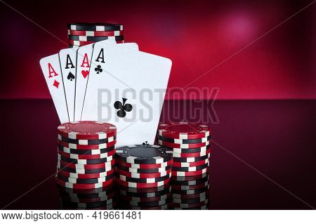 Poker Cards With Four Of A Kind Or Quads Combination. Close-up Of Playing Cards And Chips In Poker C