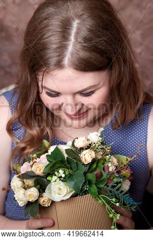 Portrait Of Fat Plump Charming Cute Woman With Curly Hair In Blue Beautiful Dress And Flowers In The