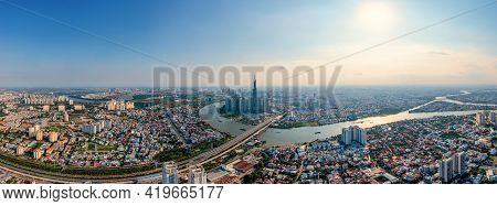 Panorama Aerial View Of Saigon Or Ho Chi Minh City Under Blue Sky
