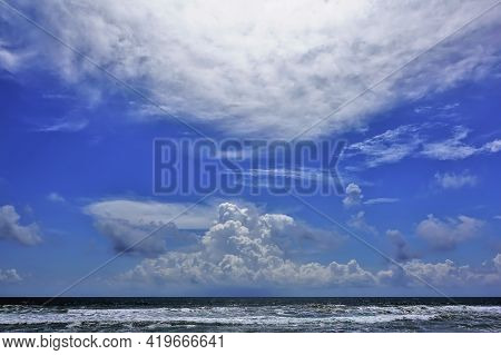 Fantastic Cloudscape Over The Ocean. There Are Picturesque Cumulus And Cirrus Clouds In The Azure Sk